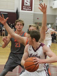 Seaholm senior Aidan Kowalski (0) grabs an offensive rebound in Friday's non-league game against Brother Rice.