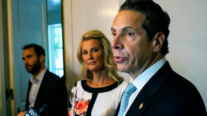 Gov. Andrew Cuomo stands with his partner, Sandra Lee, while addressing the media Sept. 9 after voting in the primary at the Presbyterian Church of Mount Kisco.