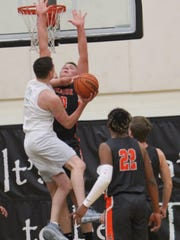 West Salem's Kyle Greeley goes to the basket against