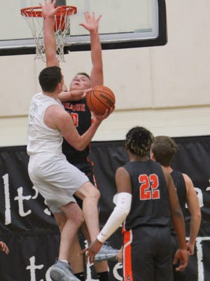 West Salem's Kyle Greeley goes to the basket against Sprague's Teagan Quitoriano  on Tuesday, Feb. 6, 2018.