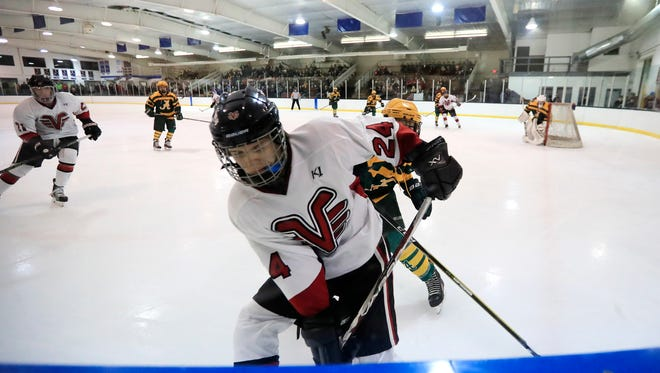 De Pere's Nick Larson (24) plays along the boards against Ashwaubenon in a FRCC hockey game at the De Pere Ice Arena on Friday, January 19, 2018 in De Pere, Wis.Adam Wesley/USA TODAY NETWORK-Wisconsin