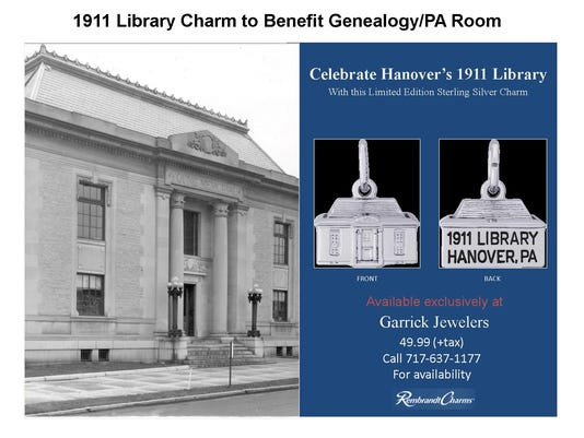 A poster shows an old image of Guthrie Memorial Library next to the charms being sold to raise funds for library projects.
