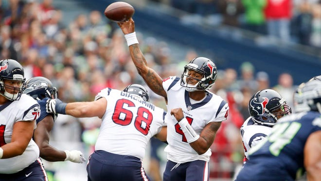 Texans quarterback Deshaun Watson passed for 402 yards and four touchdowns on just 19 completions in Seattle.