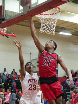 Jayveous Mckinnis and Brandon beat Petal in the Region 5-6A consolation game on Friday.