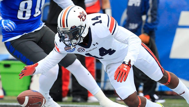 Auburn Tigers defensive back Stephen Roberts (14) falls on the ball after it was blocked when Memphis Tigers attempted a field goal in the 2015 Birmingham Bowl at Legion Field.