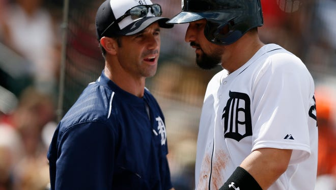 Tigers manager Brad Ausmus checks on third baseman Nick Castellanos after he scored in the second inning when he was hit by a pitch during their 15-2 win over the Orioles in Grapefruit League on Tuesday in Lakeland, Fla.