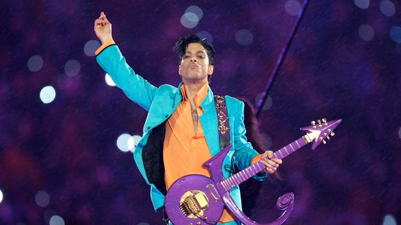 """In this Feb. 4, 2007, file photo, Prince performs during the halftime show at the Super Bowl XLI football game at Dolphin Stadium in Miami. Prince, widely acclaimed as one of the most inventive and influential musicians of his era with hits including """"Little Red Corvette,"""" ''Let's Go Crazy"""" and """"When Doves Cry,"""" was found dead at his home Thursday in suburban Minneapolis, according to his publicist. He was 57."""
