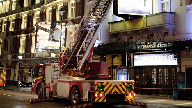 Police and fire crews in attendance on Shaftesbury Avenue outside the Apollo Theatre  on Dec. 19, 2013.