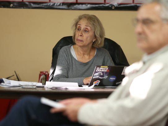Rosa Ramos Morgan listens in as Frenchtown residents
