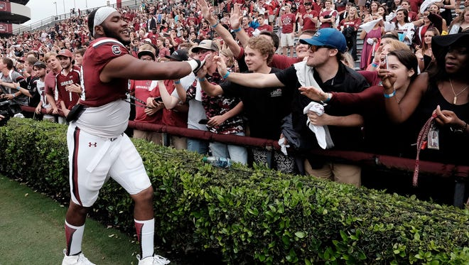Defensive tackle Ulric Jones shakes hands of South Carolina fans a win against Central Florida.