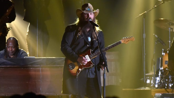 Singer-songwriter Chris Stapleton performs onstage with recording artist Justin Timberlake (not pictured) at the 49th annual CMA Awards at the Bridgestone Arena on Nov. 4, 2015 in Nashville.