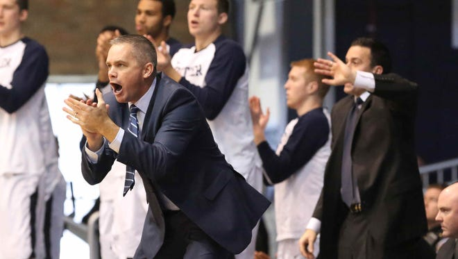 Butler coach Chris Holtmann cheers on Bulldogs players during the team's win over Indiana State, Dec. 5, 2015.