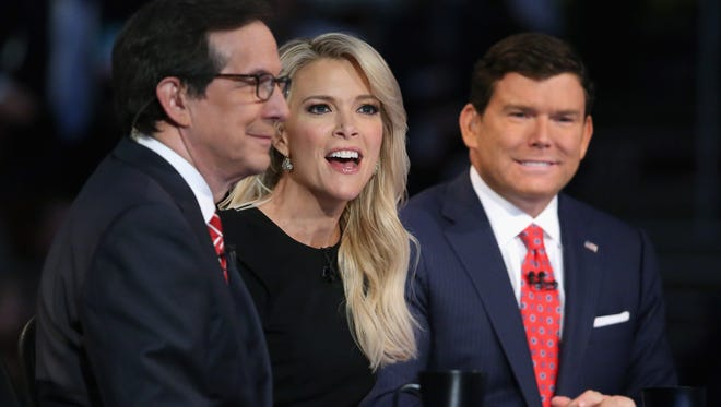 Fox News anchors Chris Wallace, Megyn Kelly and Bret Baier moderate the first prime-time Republican presidential debate in Cleveland on Aug. 6, 2015.