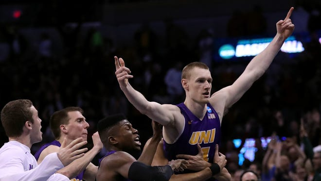 Paul Jesperson #4 of the Northern Iowa Panthers celebrates with his teammates after hitting a half court three pointer at the buzzer to defeat the Texas Longhorns with a score of 75 to 72 during the first round of the 2016 NCAA Men's Basketball Tournament at Chesapeake Energy Arena on March 18, 2016 in Oklahoma City