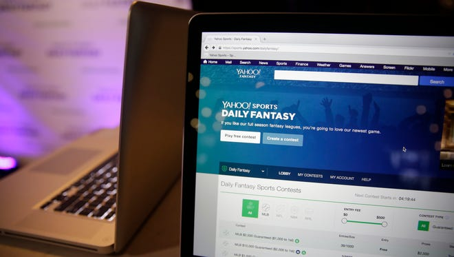A laptop screen displays the new Yahoo Sports Daily Fantasy contest during a product launch Wednesday, July 8, 2015, in San Francisco.