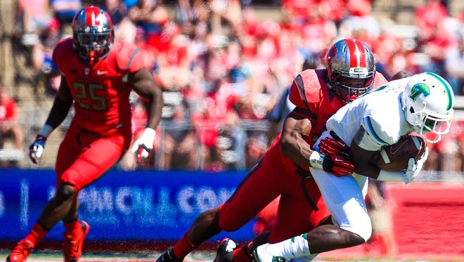 Quentin Gause makes a tackle during his standout career at Rutgers.