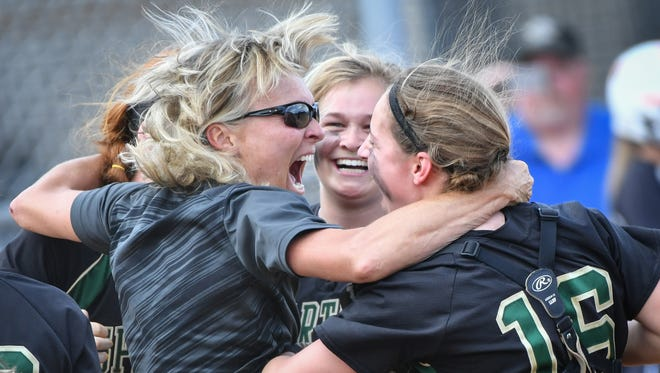 Oshkosh head coach Cindy Suess celebrates with Sammy Buerger (16) and Lauren Neveau following Oshkosh North's 1-0 win over Kaukauna in a WIAA Division 1 sectional final on Thursday,