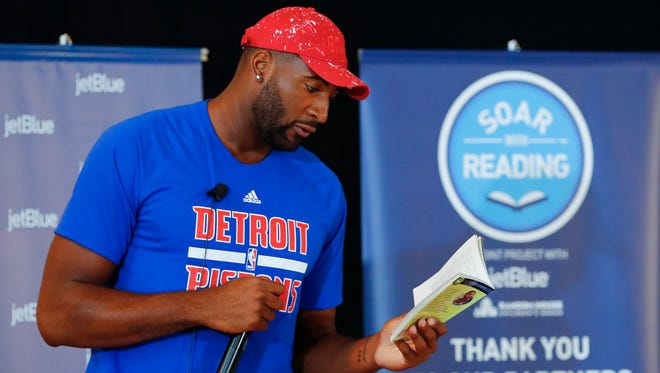 Detroit Pistons player Andre Drummond reads to local children during JetBlue's Soar with Reading event at the Matrix Center on Tuesday, Aug. 23, 2016, in Detroit.