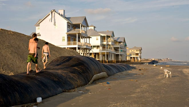 An artificial sandwall failed to protect houses in Galveston's West Beach from Hurricane Ike, which struck coastal Texas on Sept. 13, 2008. Once sea levels rise another foot, the federal government may have to choose between funding relocation of neighborhoods in Galveston or Hilton Head, S.C., or Savannah, Ga., or Miami. There will almost certainly not be enough to dike, pump out or elevate every community that needs it.