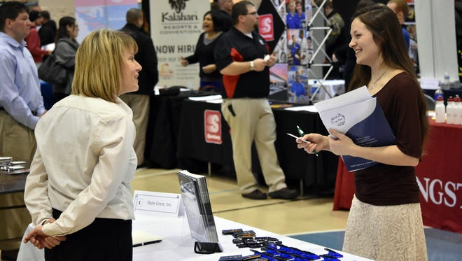 An employer meets with a student as a previous job fair at Terra State Community College.