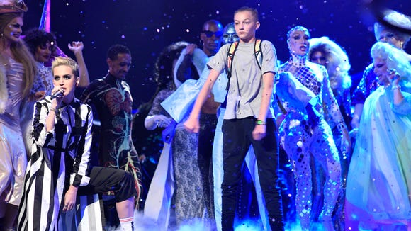 Russell Horning dances on stage while Katy Perry performs