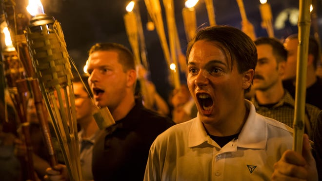 Lebanon native and former Springfield resident Ted Von Nukem, in black, was identified by a former classmate as one of the people in a viral photo from a rally of neo-Nazis, white supremacists and alt-right protesters Aug. 11 in Charlottesville, Va. Fellow protester Peter Cvjetanovic, right, was also outed and identified as a student at the University of Nevada-Reno.