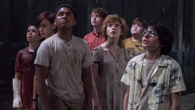 """Jack Dylan Grazer (far left), Jaeden Martell, Chosen Jacobs, Wyatt Oleff, Sophia Lillis, Jeremy Ray Taylor and Finn Wolfhard star as the young Losers Club facing off against a dark force in """"It,"""" based on the Stephen King novel."""