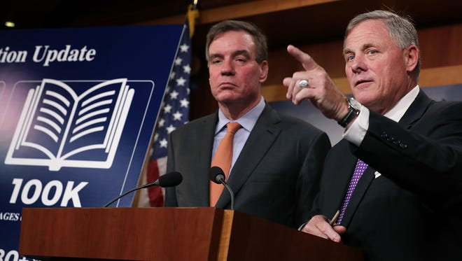 Senate Intelligence Chairman Richard Burr and Vice Chairman Mark Warner hold a news conference on the status of the committee's inquiry into Russian interference in the 2016 election at the U.S. Capitol on Oct. 4, 2017.