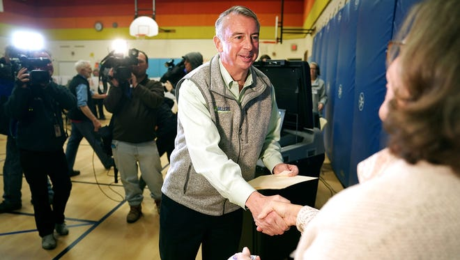 Ed Gillespie shakes hands with a poll worker after casting his vote in the gymnasium at Washington Mill Elementary School on Nov. 7, 2017, in Alexandria, Va.