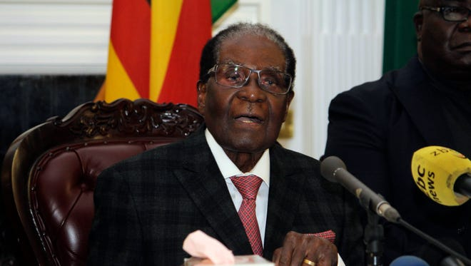 Zimbabwean President Robert Mugabe delivers his speech during a live broadcast at State House in Harare, Sunday, Nov, 19, 2017.