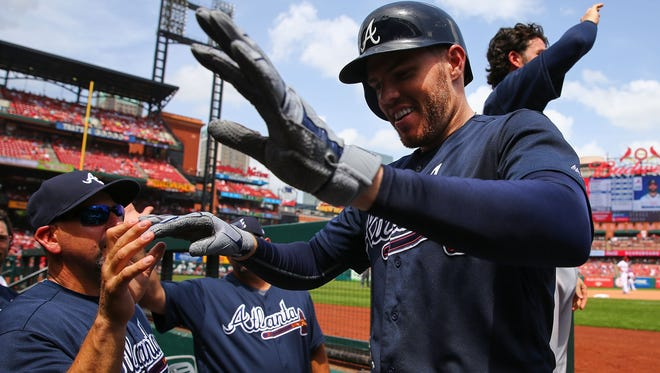 Freddie Freeman's two-run homer boosted the Braves to a series sweep at St. Louis.