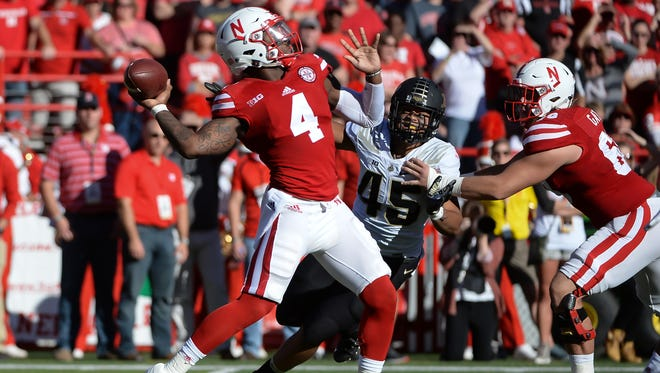 Quarterback Tommy Armstrong Jr. of the Nebraska Cornhuskers prepares to pass against the Purdue Boilermakers at Memorial Stadium on Oct. 22.