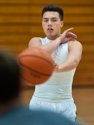 University of Vermont men's basketball freshman Ernie Duncan makes a pass during practice last week.