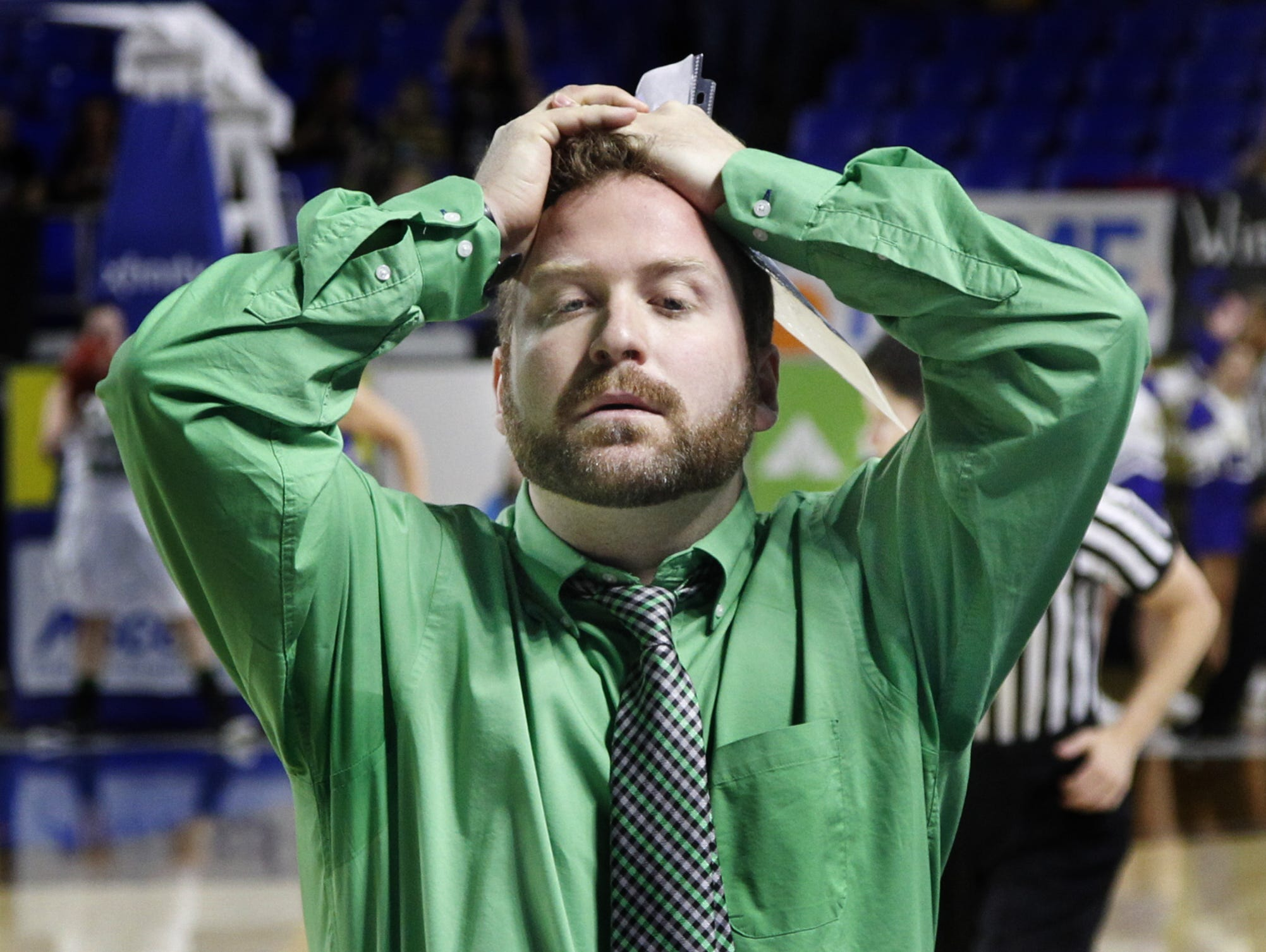 Houston County coach Sam Young reacts after a missed shot against Clarkrange during the Class A quarterfinal State Basketball Tournament in Murfreesboro during the 2014-15 season.