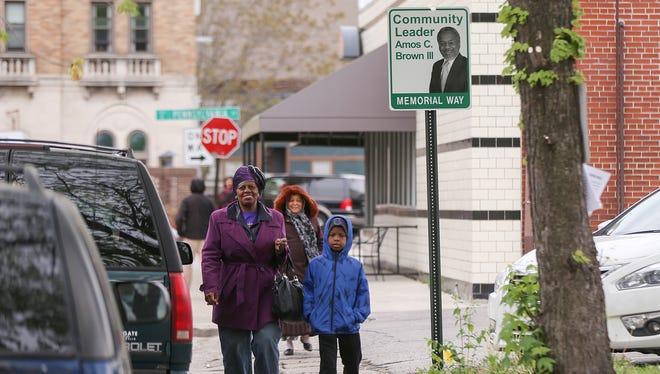 New signs mark Amos Brown Memorial Way on St. Joseph Street between Meridian and Pennsylvania, Indianapolis, Saturday, April 22, 2017.