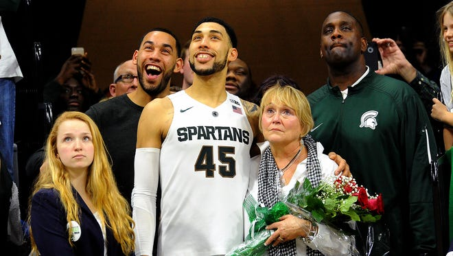 Dave Wasinger/Lansing State Journal MSU senior Denzel Valentine stands with his family, from left to right, brother Drew, mother Kathy and father Carlton, as he is honored during senior day festivities after the Spartans? 91-76 win over Ohio State Saturday at Breslin Center. MSU senior Denzel Valentine stands with his family, from left to right, brother Drew, mother Kathy and father Carlton, as he is honored during senior day festivities after the Spartans' 91-76 win over Ohio State Saturday at Breslin Center.