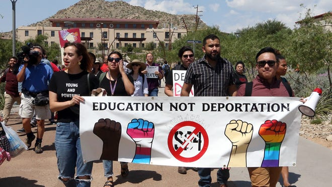 A pro-DACA group walks to the administration building to deliver a petition to UTEP President Diana Natalicio after a rally on campus in September.