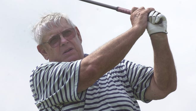 Tommy Veech watches his shot at the Bent Pine Golf Club in Vero Beach, Fla., in 2001.