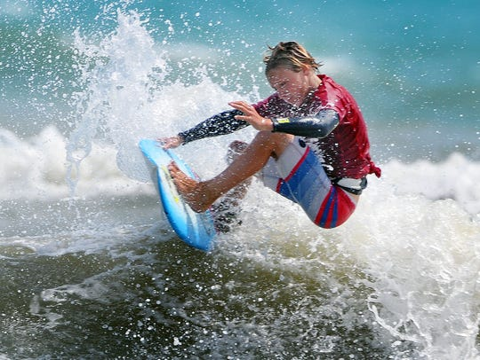 Blake Elmore of Daytona Beach carves up a nice wave during the men's shortboard final during the 52nd annual Easter Surf Festival held at Lori Wilson Park in Cocoa Beach.