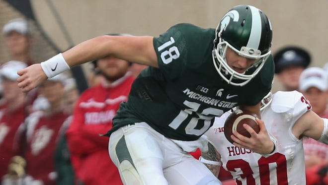 Michigan State QB Connor Cook runs for a first down against theHoosiers during the first half Saturday in East Lansing.