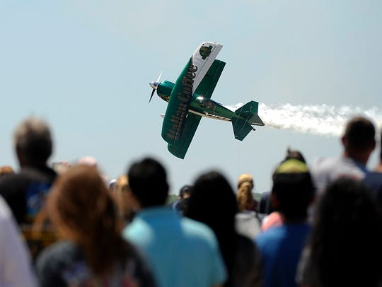 Stunt pilot Jason Newberg performs for the crowd during