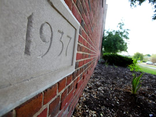 A cornerstone marker indicates that construction began