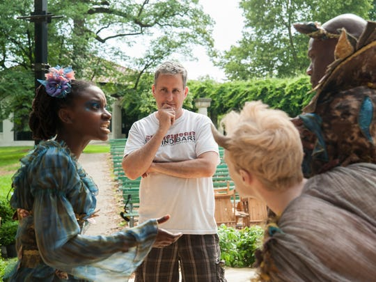 """Kentucky Shakespeare producing artistic director Matt Wallace, center, works wtih actors Tia Davis (Titania), Tony Milder(Puck) and Dathan Hooper (Oberon) during the staging rehearsal for """"A Midsummer Night's Dream"""" in on the set in Central Park  in the summer of 2014."""
