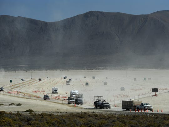 Camping vehicles are seen streaming off the playa after the end of Burning Man on Tuesday, Sept. 8, 2015.