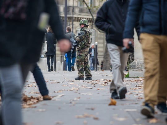 A French soldier patrols outside the French National