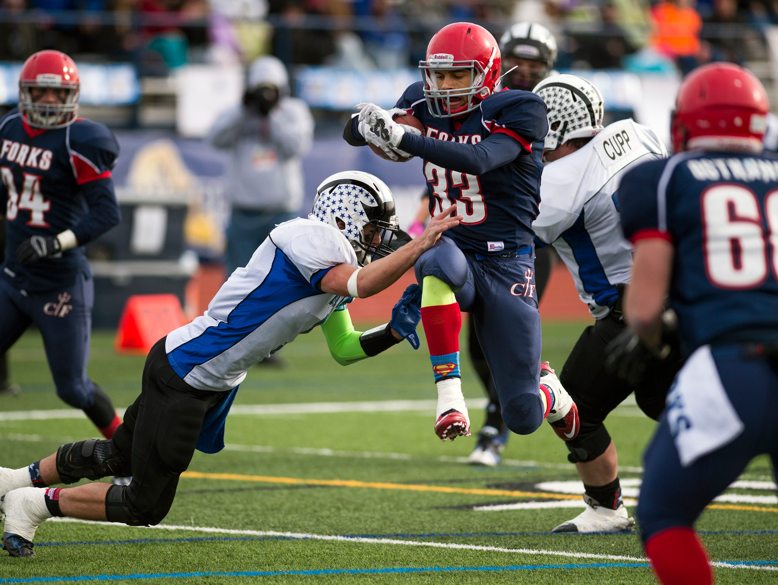 Chenango Forks running back LJ Watson hurdles past a Bath defender on his way to the endzone in the second quarter of the Class C state playoff semifinals on Saturday, Nov. 21, 2015.