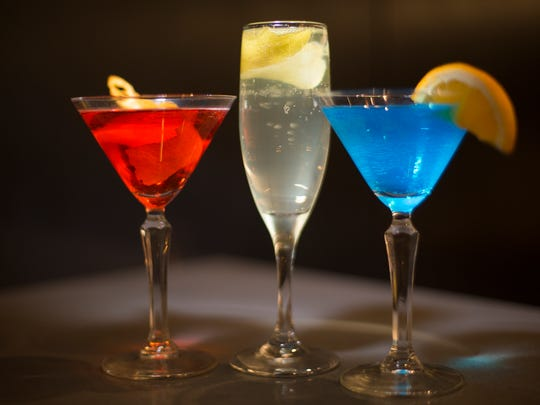 Signature drinks French 75, left, Negroni and Blue