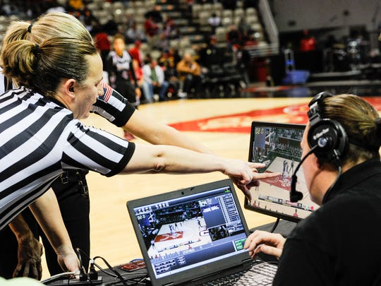 Game officials take a look at the replay to get the right call as the Cajuns take on Troy in an ESPN televised game in the Cajundome. Jan 23, 2016.