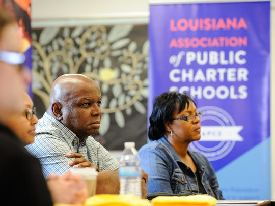Rogers Griffin, the principal of Holy Family Catholic School, and Andrea Moore, a Holy Family parent, listen during a roundtable discussion on school choice Wednesday at Willow Charter Academy.