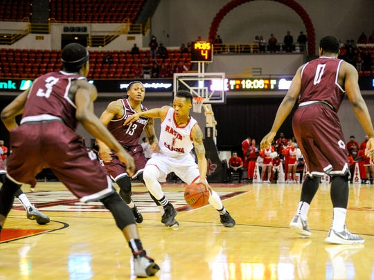 UL point guard Jay Wright dribbles to the basket in UL's loss to Arkansas-Little Rock on Saturday the Cajundome.